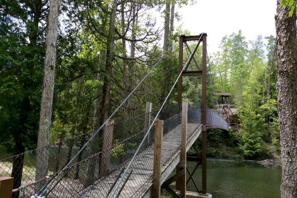 The suspension bridge at Pickett State Park leads runners in or out of the park depending on the year of the race. Pickett serves as a major aid station and crewing location.